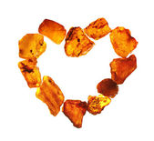 Amber in the shape of a heart — Stock Photo