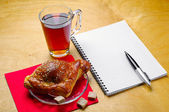Croissant and cup of tea — Stock Photo