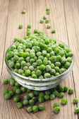 Frozen peas in a glass bowl — Stock fotografie