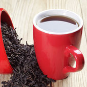 Cup of tea and dry black tea — Stock Photo