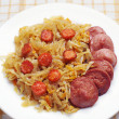 Braised cabbage with sausage — Stock Photo