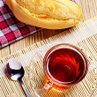 Cup of tea and bread — Stock Photo