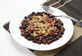 Gray peas with bacon and sausage — Stock Photo