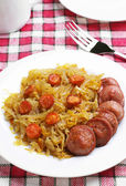 Braised cabbage with grilled sausage — Stock Photo