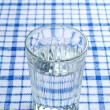 Transparent faceted glass of water — Stock Photo