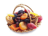 Different dried fruits in a basket — Foto de Stock
