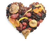 Different dried fruits in the shape of hearts — Stock Photo