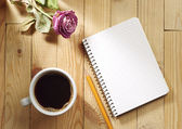Cup of coffee, dried roses and notebook — Stock Photo