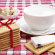 Cookies, cup with hot water and tea bag — Stock Photo