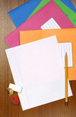 Exercise books and a single clean sheet — Stock Photo