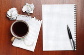 Coffee, notebook, pen and crumpled paper — Stock Photo