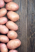Background with fresh potatoes — Stok fotoğraf