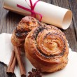 Buns with poppy seeds and roll paper — Stock Photo