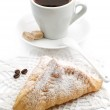 Sweet croissant and cup of coffee — Stock Photo