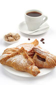 Croissants and cup of coffee — Stock Photo
