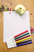 Blank sheet of school notebook and felt-tip pens of different co — Stock Photo