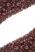 Chocolate candy and coffee beans — Stock Photo