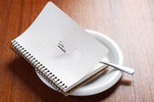 Notebook on a plate — Stock Photo
