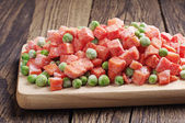 Frozen peas and carrots — Stock Photo