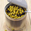 Canned green peas — Stock Photo