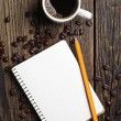 Stock fotografie: Coffee and notepad
