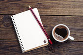 Cup of coffee and notepad — Stock Photo