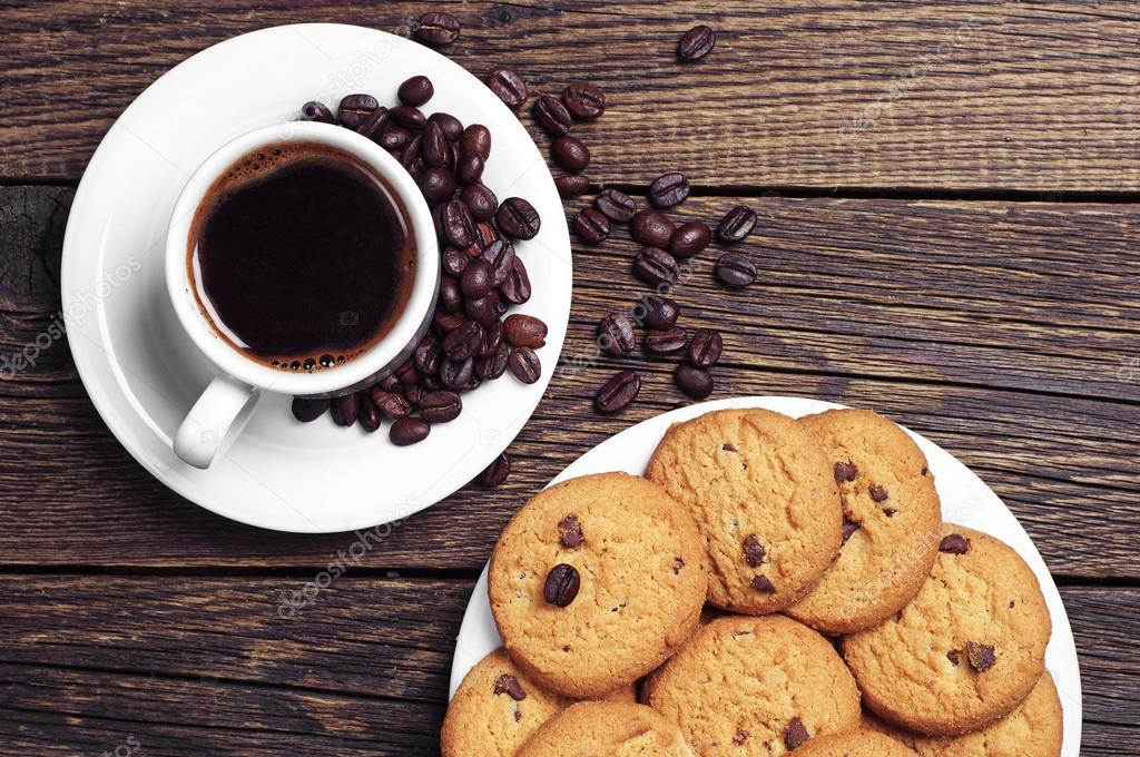 Cup of coffee and cookies — Stock Photo © Sasajo #41180955