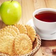 Cup of tea with cookies and apple — Stock Photo
