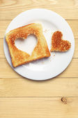 Toast bread with cut out heart shape — Stock Photo