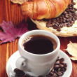 Cup of coffee and croissant — Stock Photo