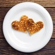 Two toast bread in the shape of hearts — Stock Photo #44036907