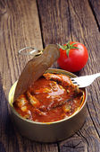Canned fish in tomato sauce — Stock Photo