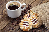 Sweet cookies and cup of coffee  — Stock Photo