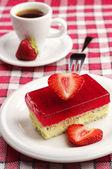 Tasty strawberry cake and coffee — Stock Photo