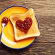 Toast bread with jam in shape of hearts — Stock Photo #49568939