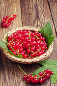 Red currants on wooden table — Stock Photo