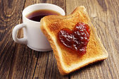 Cup of tea and toast bread with jam — Stok fotoğraf