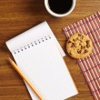Coffee and notepad with cookies — Stock Photo #50262841