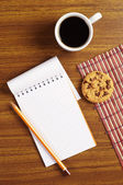 Coffee and notepad with cookies — Foto Stock