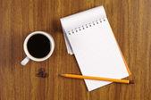 Tasse de café et bloc-notes — Photo