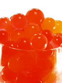 Gel beads, like the red salmon roe. — Stock Photo