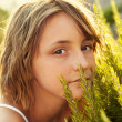 Girl in rosemary garden — Stock Photo