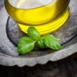 Olive oil and basil — Stock Photo