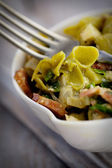 Green pasta with vegetables — Stock Photo