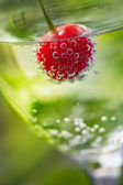 Fizzy drink with cherry — Stock Photo