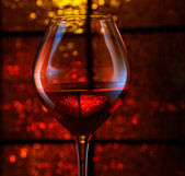 Wineglass with abstract bokeh background — Stock Photo