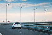 Car on highway curve — Stock Photo