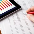 Stock Photo: Analyzing financial report