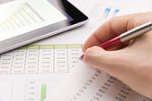 Analyzing financial report — Stock Photo