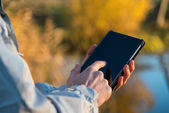 Using tablet pc outdoors — Stock Photo